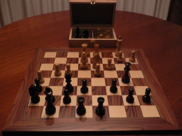 Black Boxwood Chess Set with Walnut Board and Chest. 76mm King